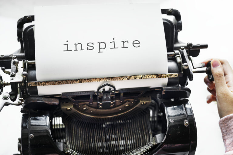 Retro Typewriter with the word Inspire
